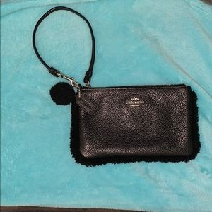 Black Coach wristlet, with sheer hair like new.